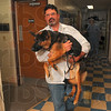 Tribune-Star/Joseph C. Garza<br /> In good hands: Michael E. Staub, DVM, of Honey Creek Animal Hospital carries Heidi back to her cage after he examined her Monday at the hospital.