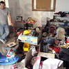 Abandoned: Phillip Morin looks at a room full of toys abandoned by the previous tennant of Deborah's House.