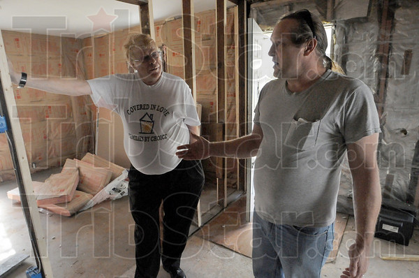 Trashed: Ben Ryan (L) and Phillip Morin talk with Tribune-Star reporter Bryan Boyce Friday afternoon from Deborah's House.