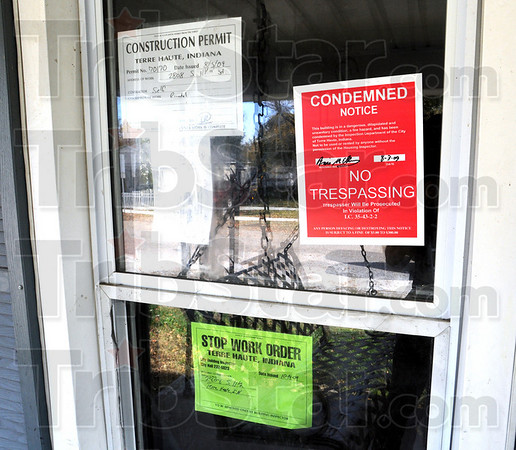 Stop - n - go: Detail photo of building permit, condemed notice and stop work order on Deborah's House.