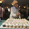 Tribune-Star file photo/Joseph C. Garza<br /> Is that a trick candle?: Eighty-seven-year-old Bettie Davis questions a candle she can't quite blow out during a birthday celebration Sunday, March 1 at the Allen Chapel AME Church. At left is Aletha Carter.