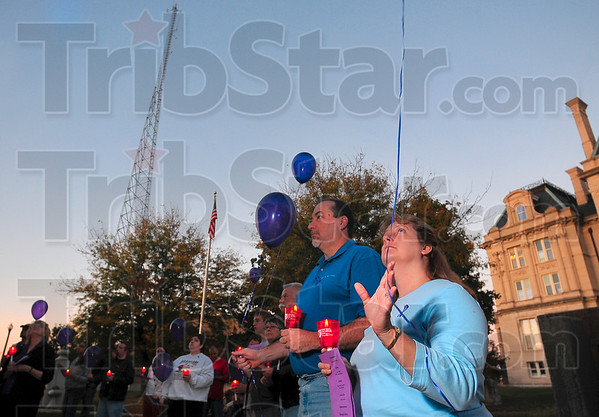 Tribune-Star/Joseph C. Garza<br /> For all of them: Deputy prosecutor for domestic violence Raeanna Moore releases a purple balloon for all of the victims she has encountered during the CODA 2009 Candlelight Vigil in front of City Hall Monday evening.