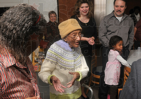 Tribune-Star file photo/Joseph C. Garza<br /> She knew something was up: Bettie Davis, center, discusses she knew something was afoot, like a surprise birthday party, from how her friends and family were acting Sunday, March 1 at the Allen Chapel AME Church.