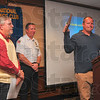Tribune-Star/Joseph C. Garza<br /> Humble hero: Terre Haute Fire Department firefighter Michael L. Likens thanks the members of the Exchange Club of Terre Haute after he accepted the club's Firefighter of the Year award Tuesday at the Holiday Inn. Looking on is club member Mike Ireland and Terre Haute Fire Chief Jeff Fisher.