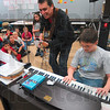 "Tribune-Star/Joseph C. Garza<br /> Now were jammin': Guest musical educator Randy Beard encourages Deming Elementary School fifth-grader Ian McClelland to keep up the great work on the piano as he puts the essay, ""I have better things to do than do drugs,"" to song Tuesday at the school. The poem was written by fellow student Summer Dickens."