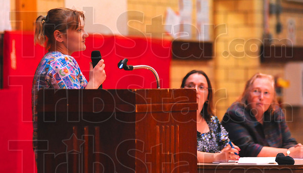 Tribune-Star/Joseph C. Garza<br /> A mother's perspective: Shannon Gillie thanks the staff at Chauncey Rose Middle School for helping her son during a forum at the middle school Tuesday.