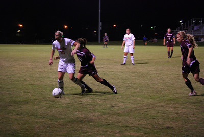 Brooke Bull guards the ball from her Winthrop opponent.