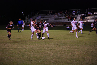 Melissa Malone and Kasy Gladhill work together to take the ball back into GWU's possession.