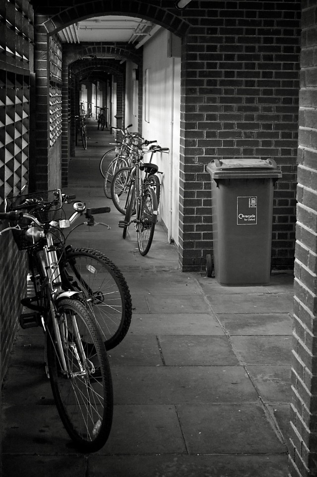 Bicycles stored under maisonettes in Pusey Lane.