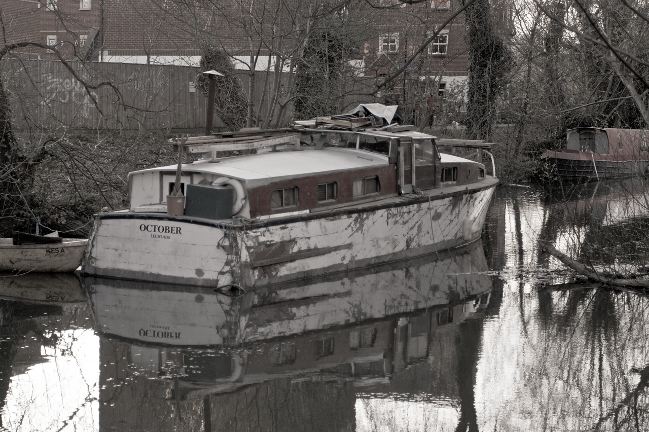 A cabin-cruiser moored along Oxford Canal.