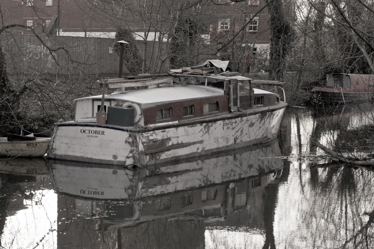 A cabin-cruiser moored along Oxford Canal.
