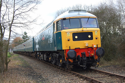 47580 'County of Essex' awaits departure from Wymondham Abbey with the 1200 to Dereham. 47596 is visible on the rear of the train (28/02/2009)