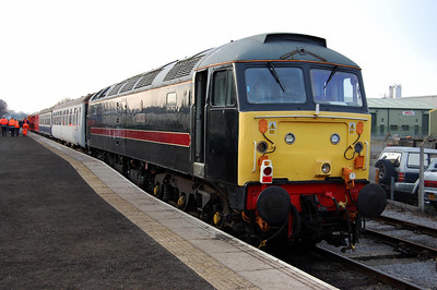 Still sporting its original 'Fragonset' livery applied in 2003, 47715 'Poseidon' is pictured on the rear of the 1205 to Redmire at Leeming Bar (04/01/2009)