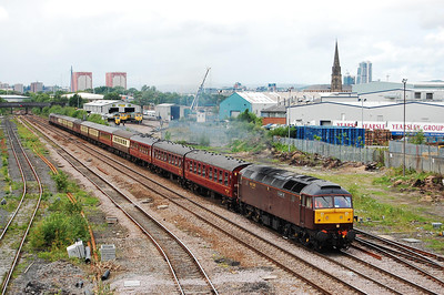 47786 'Roy Castle OBE' accelerates past the Freightliner depot at Midland Road, Leeds, with 5Z45 1125 Carnforth-Doncaster West Yard. The stock was for the next day's Railtourer charter to Canterbury (22/05/2009)