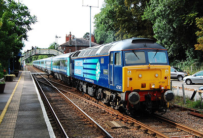 Within an hour of a torrential downpour on the coast, 47501 heads 5G96 1650 ecs from Norwich back to Lowestoft in bright sunshine at Brundall (24/07/2009)