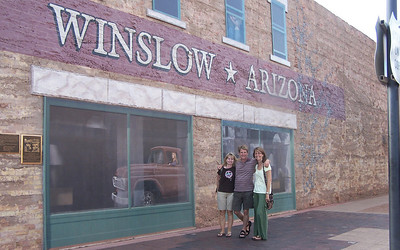 """From the lyrics of """"Take It Easy,"""" from the Eagles' first album in 1972:  """"Well, Im a standing on a corner in Winslow, Arizona And such a fine sight to see Its a girl, my lord, in a flatbed Ford, slowin' down to take a look at me""""  So there's actually a corner in Winslow, Arizona where all of this is memorialized, and of course we had to see it. There's the girl in a flatbed Ford reflected in the window..."""