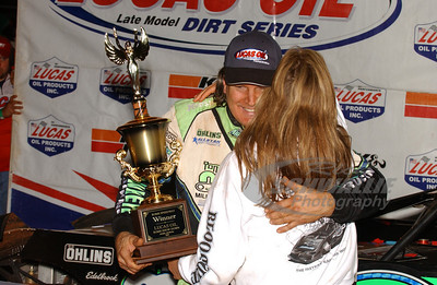Scott Bloomquist gets a hug from wife Katrina in Victory Lane @ Rome Speedway
