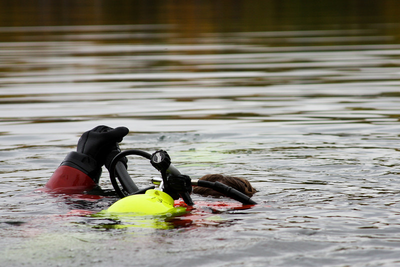 A press of a button and air is released, sending Tracy under the lake's surface.