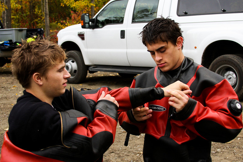 James and Jon lend each other helping hands in the donning of their cumbersome drysuits before getting in the water.