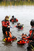 Mat-Su Water Rescue Team members in various states of readiness for the dive.
