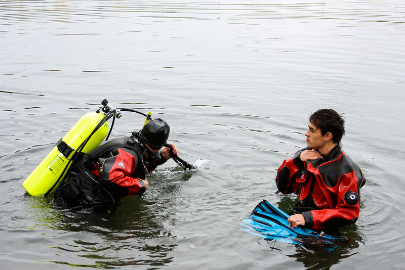 Tom and Jon King take advantage of the water's weakening effect on gravity to don their heavy and awkward gear.