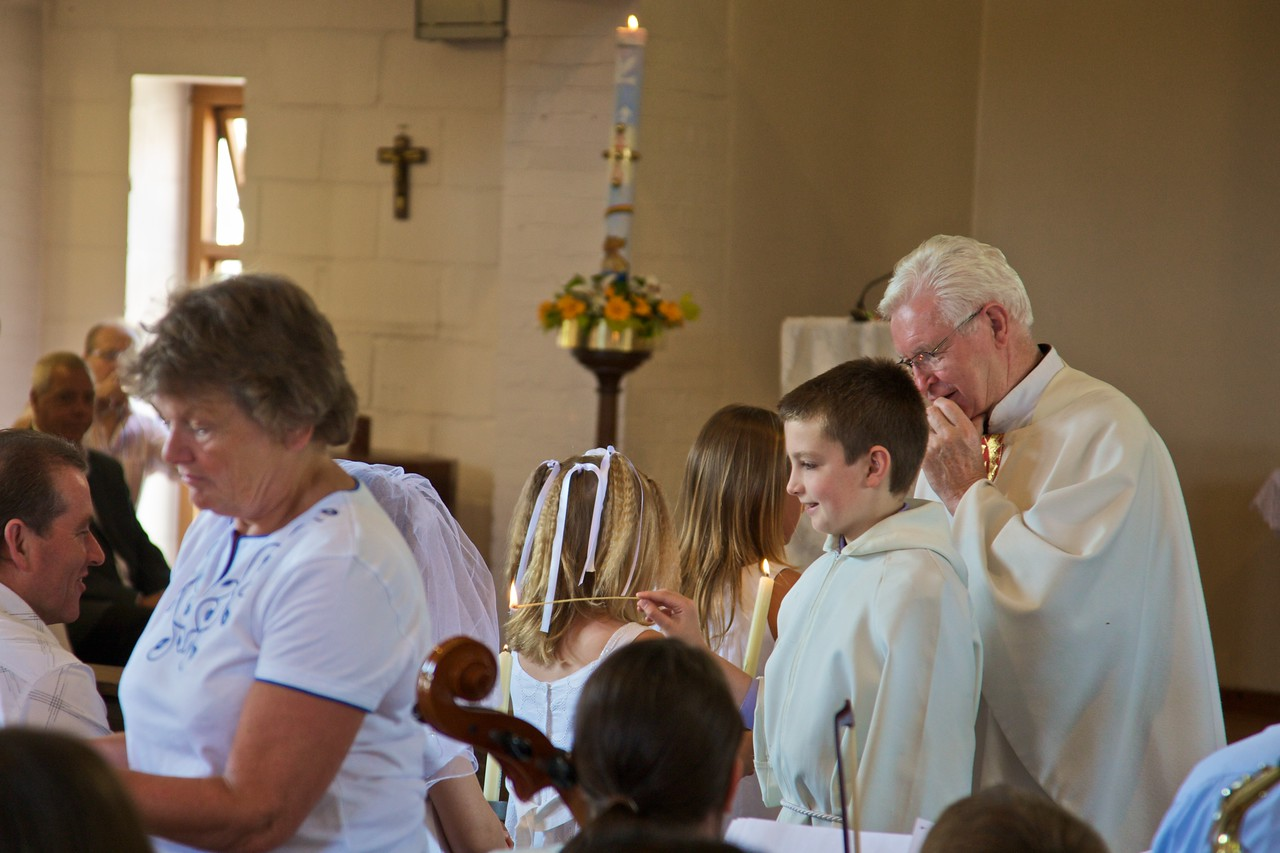 George lighting First Communicants' candles.