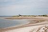 Side beach and lighthouse
