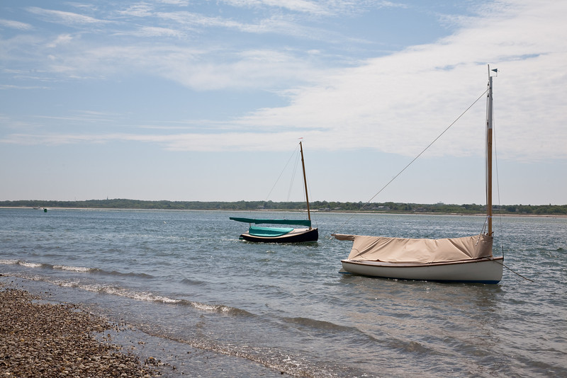 Sailboats moored on front beach