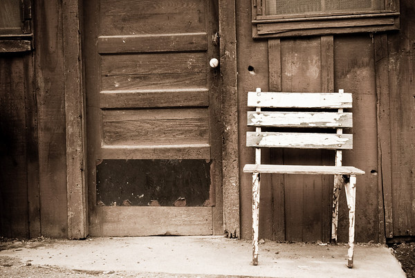 Old wooden chair and barn at Pichetti Winery