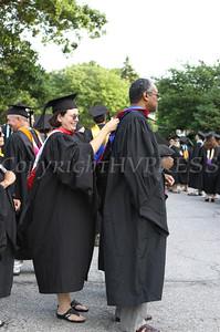 "A Newburgh Free Academy teacher lends a ""helping hand"" to a fellow teacher prior to the 144 commencement exercises on Thursday, Juen 25, 2009. Chuck Stewart, Jr./HUDSON VALLEY PRESS"