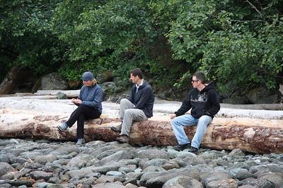 Susan, Christian, and Scott sitting on a log at a rest on our first day.