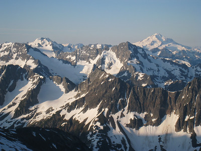 Dome Peak on the right, with Glacier Peak on the right in the distance.  Formidable and Mixup also in the foreground
