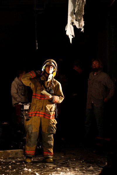 Battalion Chief Randy Newcomb inspects the burn for signs of remaining heat as crews mop up the last of the fire.