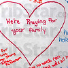 Tribune-Star/Joseph C. Garza<br /> In their thoughts and prayers: A note sits in the outline of a heart on the large poster board card for Terre Haute South student Patrick Duong whose brother, Peter Duong, was killed Wednesday on the Indiana University campus in Bloomington.