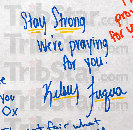 Tribune-Star/Joseph C. Garza<br /> A message of hope: Terre Haute South students took time Thursday to sign a card for classmate, Patrick Duong, after his older brother and South alumnus, Peter Duong was killed after he was struck by a car Wednesday on the Indiana University campus in Bloomington.