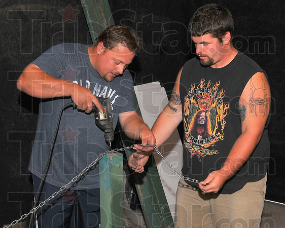 Guide lines: Paco Hoopingarner and Dusty Coffey work together Thursday evening to get the haunted house ready as a fundraiser for the Terre Town baseball league.