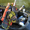 Safe: A hovercraft rescue team hauls in a boating accident victim during the making of a documentary film Thursday afternoon on the Wabash River.