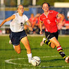 Contested: Lady Patriot Nicole Mikolajczyk(7) and Terre Haute Souths' Kayla Liffick(6) race to the ball in first half action on the Terre Haute Northpitch Thursday evening.