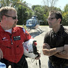 Coordination: Tad Skylar Agoglia (R) and Air Evac Lifeteam member Jeremy Bowman talk about a rescue operation that will be filmed for a documentary on the First Response Team of America's hovercraft rescue operations Thursday afternoon.