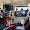 Air Evac: Film crews and emergency personnel can be see through the window of an air evacuation helicopter involved Thursday afternoon. They are collaborating in a documentary film about the voluntary First Response Rescue Team of America.