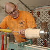 One good turn: David Gahimer turns a piece of spalted beech on a lathe at the Terre Haute Street Fair Thursday evening. He creates bowls and containers from wood based on ancient designs.