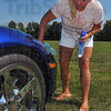 Time to shine: Patty Peter puts the finishing touches on her 2007 Corvette for the car show that was part of the Wabash Valley Musicians picnic and jam session at the VFW Post 972 Recreation Cneter.