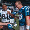 Tribune-Star/Joseph C. Garza<br /> They can still laugh when it's over: Jacksonville's Torry Holt and Indianapolis' Peyton Manning share a laugh after the game Sunday in Indianapolis. The Colts won 14-12.