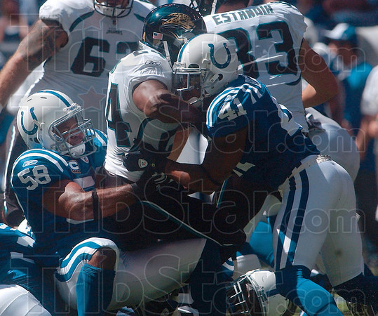 Tribune-Star/Joseph C. Garza<br /> Team effort: Indianapolis linebacker Gary Brackett (58) and defensive back Antoine Bethea (41) stop Jacksonville fullback Montell Owens from gaining any more yardage during the Colts' 14-12 win Sunday in Indianapolis.