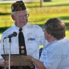 Honored: Jim Flinn of VFW Post 972 accepts a certificate from Sue Muncie of Maple Avenue United Methodist Church.  He and other members of various civil organizations recieved the certificates recognizing their contributions to their city and country at an outdoor church service Sunday morning.