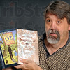 Author: Jamec C. Wallace II poses with his book Magician of Oz.