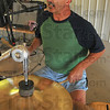 Rocking away: George Rusin supplies the beat and vocals during the Sunday afternoon jam session of the Wabash Valley Musicians.