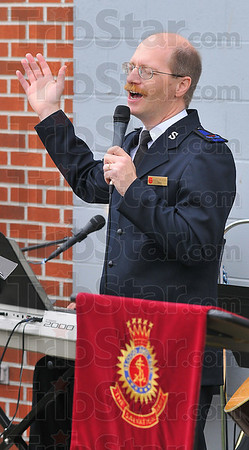 """Sing praise: Salvation Army Envoy Gordon Hoag led the song service during their """"Meeting on the Green"""" Sunday morning."""