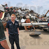 Regular: Tom Haley knows many of his suppliers on a first name basis. Here he chats with Ryan Plasse who is dropping off scrap items from his grandmother's property after a Spring clean-up day.