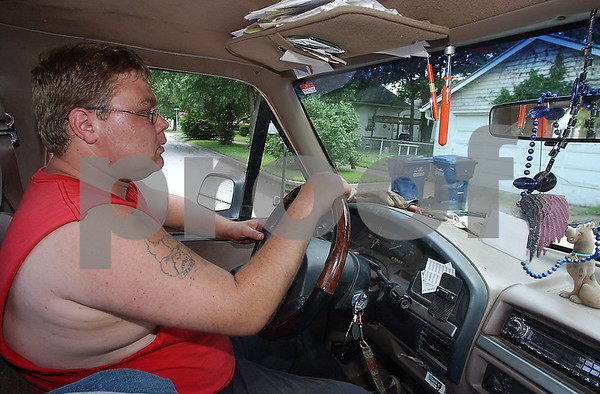 Know your territory: Charles Farner drives the alleys on the south side of Terre Haute in mid June. He knows the trash pickup days for the different areas of the city which allows him to collect recyclable scrap metal that might otherwise end up in the landfill.